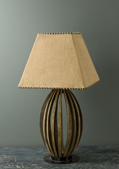 lamp made from reclaimed french wine barrels  Use this concept to design a lamp base.