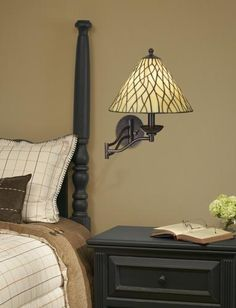 Tiffany swing arm light and bedroom design.