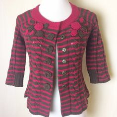 Moth striped knit cardigan Raspberry and chocolate striped cardigan with appliqué rosettes on either side of chest as well as form the front snaps. 3/4 sleeves. Light pulling under arms and in fabulous condition. Anthropologie Sweaters Cardigans