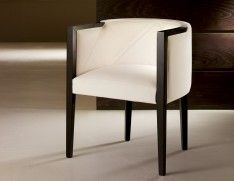 Venere Italian designer side chair handmade and shown in oak. This luxury Italian furniture collection features a wide selection of finishes including oak wenge, ebony and various lacquered colors. Samples available upon request. Made in Italy.