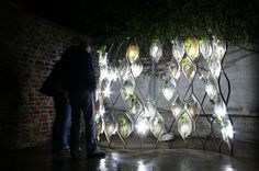 The Night Garden is a vertical landscape built of glowing porcelain tiles within a steel structure supporting translucent vessels designed to hold water & flowers such as evening primrose, moonflowers & brassavola. The flowers were chosen due to their fragrant nature & night blooming characteristic.