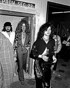 Bonzo, Robert Plant and Jimmy Page holding his best friend