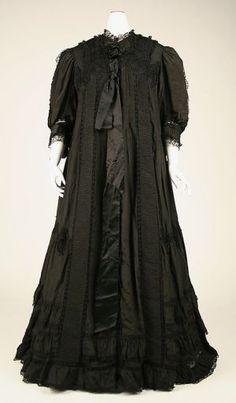 Historical maternity wear - black night dress.