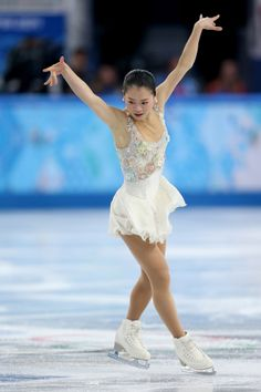 SOCHI, RUSSIA - FEBRUARY 20: Akiko Suzuki of Japan competes in the Figure Skating Ladies' Free Skating on day 13 of the Sochi 2014 Winter Olympics at Iceberg Skating Palace on February 20, 2014 in Sochi, Russia. (Photo by Matthew Stockman/Getty Images)