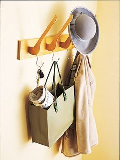 Unique Coat Rack        Mounted hangers serve as a unique coat rack for easy entryway organization. Attach sawed-off wooden hangers to a board by screwing them in through the back. Add heavy-duty picture hangers to the back of the board for mounting on the wall. Throw hats on top and hang purses and coats on the hangers' hooks.        Watch the Video