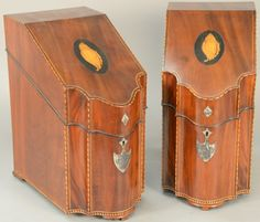 Pair of inlaid mahogany knife boxes, each with hinged canted lid with conch shell inlay opening to reveal fitted interior having a serpentine front with silver escutcheons, American or English circa 1790-1810.