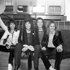 The four members of the rock band 'Queen' arrive back from their tour...