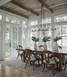 Beautiful chairs, windows, ceiling and look at the herringbone brick floor pattern that makes you think its a rug!