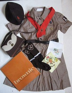 The Brownie Uniforms we wore.  I purchased one from ebay like this so my granddaughter could wear it to her GS meeting showing Brownies Girl Scouts through the years.