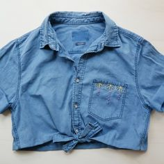 In this post we have shown you how to refashion an unwanted denim shirt into a sweet cropped bow blouse with embroidered details!