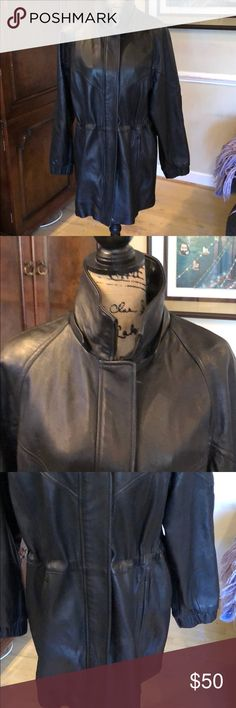 """Black leather short trench Black leather jacket  100% leather & extremely soft (Note this originally had a removable hood with fur I no longer have it as I removed it) In excellent condition- barely worn  I hate to part with but I rarely Wore and now too big.  33"""" in length  Adjustable waist Colebrook Jackets & Coats Trench Coats"""