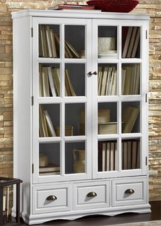 The addition of space saving furniture will go a long way toward corralling clutter and adding a sense of style to your space. Let a large cabinet with glass doors serve as your personal library to hold books, magazines, videos and games. It will instantly add order to what can often become a jumbled mess.