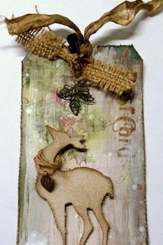 I finished tag No. 2 and once again I didn`t have the  paper, the distress stain and a little green pine wreath. I thought a little gesso m...