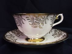 A personal favorite from my Etsy shop https://www.etsy.com/ca/listing/167772429/royal-albert-unnamed-teacup-white-w-gold