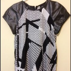 Mossino black white blouse Leather shoulders. Great condition. Size: small. But It fits bigger sizes. Mossino  Tops Blouses
