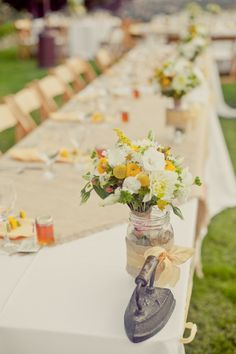 wedding flowers table decoration yellow beige rustic summer spring wedding outdoor