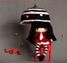 Eugene. The Doll in striped stockings via Craftsy