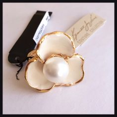 NEW Kenneth Jay Lane Pearl & Enamel Flower Ring *Brand New with Tag* Kenneth Jay Lane Enamel Flower Ring with Pearl - color: Cream/Gold - Whimsical enamel flower ring with gold colored metal. Pearl (costume) center. Adjustable band best fits 5-8. Never worn. Kenneth Jay Lane Jewelry Rings
