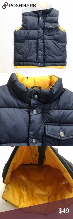 BABY GAP [boys] Navy blue yellow Puffer Vest Gently worn a few times. Heavy puffer vest with fleece lining and yellow. Pockets and buttons on front of vest. GAP Jackets & Coats Vests