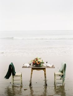Rustic  Chic Wedding table setting on the beach