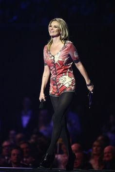 Kate Moss collected the Best British Male award on behalf of David Bowie and wore a vintage stage costume from Bowie's 1972 Ziggy Stardust tour.