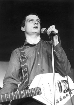 Ian Curtis with his  white Vox Phantom VI Guitar...