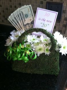 """30th Birthday Gift idea ....  so they say """"30 is the new 20"""", right?  Individual or group party gift idea for birthday boy or girl!  Can only take credit for the idea, the creative completion credits to JJMcD!    Moss covered purse planter/vase ($6 from Wegmans!) with fresh flowers and of course, new 20s !! Turned out spectacular...just had to share!"""