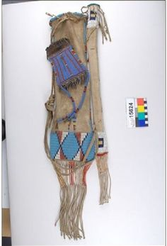 Sioux pipebag with stem case.  A strike a lite lying on top.  Field Museum