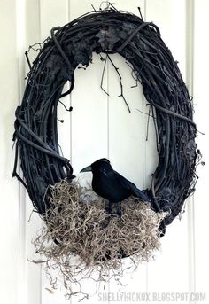 Bird's Nest Wreath, but leave the grapevine wreath brown, and add some berries, use green moss