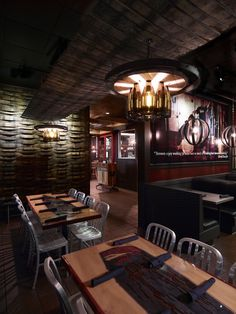 Cigar City Brew Pub in Tampa, FL. Fabricated by Mesh: Beer Barrel Wall Cladding   Wood + Resin Tables   Custom Light Fixtures