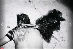 """Photographer Letizia Battaglia documented the height of violence in Palermo, Sicily during the Mafia wars from the to the This image was taken in 1982 and titled """"The Two Christs"""" Mafia, Forensic Photography, Documentary Photography, Sleep With The Fishes, Christ Tattoo, Eugene Smith, Real Tattoo, Photo Report, Photo Projects"""