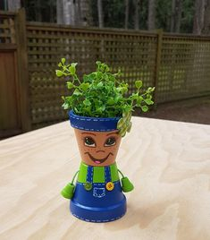 This little country girl clay pot people succulent planter by Pot Mama is hard not to love with her cheerful smile that will brighten every day. Flower Pot People, Clay Pot People, Succulent Pots, Succulents, Little Country Girls, Pots D'argile, Kids Clay, Clay Flower Pots, Painted Clay Pots