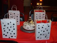 Party at the fire museum!  Make a dalmatian cake with regular and mini m-n-m's and sponge paint white gift bags for the goody bags.