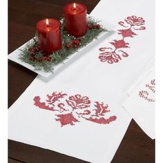 """Village Linens Holiday Filigree Table Runner Stamped Cross-Stitch by Village Linens. $14.99. Instantly transform a table into a holiday celebration! Table runner is stamped for cross-stitch on white 100% polyester fabric with a finished edge. Includes instructions. Approximately 14 x 44"""" (36 x 112cm). Imported."""