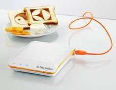 The Scan Toaster, designed by South Korean designer Sung Bae Chang for the Electrolux Design Lab 2008 competition, can print the news, weather forecasts and photos directly onto the bread. The concept is simple -- just plug the toaster into a free USB port, place the bread, and the software will burn whatever it is you want.