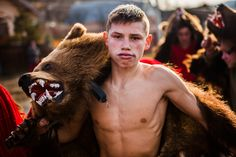 Men, women and children wearing real bear skins take to the streets to dance in this unusual New Year celebration. The Beautiful Country, Evil Spirits, New Year Celebration, Brown Bear, Kids Wear, Romania, Dance, Photography, Animals