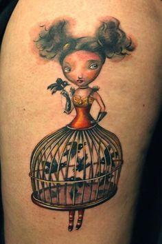 Bird cage girl tattoo