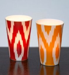 Ikat votive candle holder pair. Trendy graphic gives any room a burst of spirit and energy.  White porcelain is sandblasted to allow the pattern to shine through. WAS $24.95 NOW $5.75 while supplies last