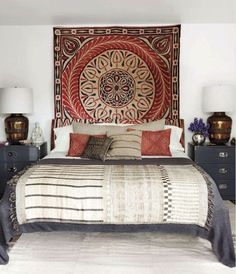 lovely bedroom space and beautiful wall hanging behind the bed too