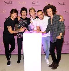 The boys at their perfume launch today in New York on Aug 5, 2014