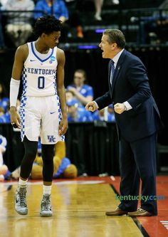 Kentucky head coach John Calipari talked to Kentucky guard De'Aaron Fox (0) in the second half of the Kentucky vs Wichita State NCAA Tournament second round game at Bankers Life Fieldhouse in Indianapolis on March 19, 2017. Kentucky beat Wichita State 65-62.