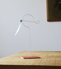 Design by Tio. A game for all ages, the Hand-held feather mobile can be held or left on its base, to be placed on a window-sill or desk.