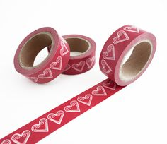 Single roll of washi masking tape with red swirl hearts pattern. Great for travel journals, scrapbooking, gift wrapping, decorating cards and envelopes and more! Add a little dash of cuteness to any c