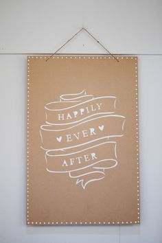 Kraft paper with white ink 'happily ever after' sign -  Image by Ali Lovegrove Photography - A wedding at Halstead House with a pink and grey colour scheme and the groom wearing Ted Baker with photography by Ali Lovegrove Photography