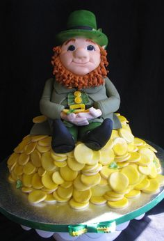 Leprechaun Cake Leprechaun is made of a 3 layer chocolate cake (fondant face/arms/legs). Pile of gold is a 4 layer cake carved to resemble...