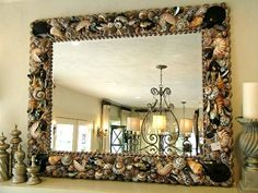 ElegantShells.com Heather Kendall Designs Custom seashell mirrors, shell chandeliers, shell fireplace surrounds. etc.
