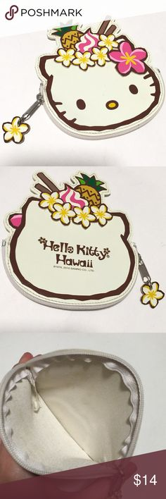 "Hello kitty Hawaii clutch coin purse bag CUTE hard to find Hawaii print! Tropical Hawaii hello kitty coin purse clutch, so adorable and gently used showing minimal wear, inside is a bit dis colored. Outside looks great may have a few scuffs but no deep scratches, holes or stains. Pretty plumeria flowers and pineapple and plumeria on zipper pull. Measures about 5""x4.5""   Great In a purse, backpack For school bag, cute work accessory, thrown in a beach bag, for traveling, display room…"