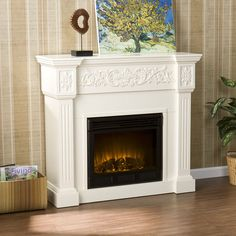 """Pictured above is the 44.5"""" Holly & Martin Huntington Electric Fireplace shown in a charming ivory finish. With an enamoring floral design daintily featured on the façade of the upper mantel, the Huntington has been outfitted with many smart features that ensure safety. Offering 5,000 BTU's, this beautiful electric fireplace will heat a 1,500 square foot room in less than 24 minutes!"""