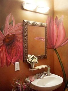 Love the oversized flowers painted in this gold powder room.