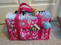 URU Keep-It Caddy.. used as a diaper caddy. I use a basket and just started using one of these and it a time saver. I keep it in the livingng room
